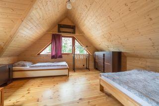 Domki 8 DĘBÓW Pobierowo Sypialnia duży domek
