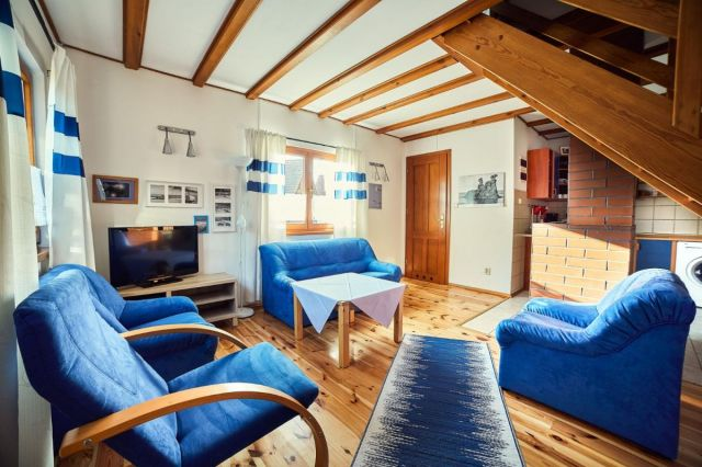 Domki Drewniane Całoroczne PLEJADY Dźwirzyno Domek 6 osobowy - salon z kominkiem