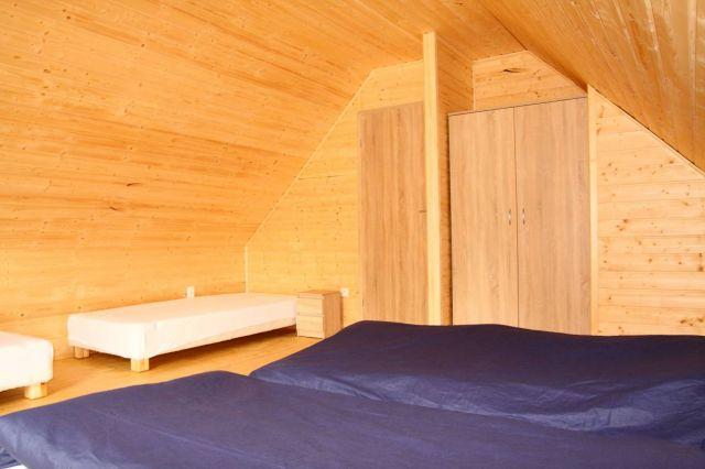 Domki NEMO Gąski Duża sypialnia