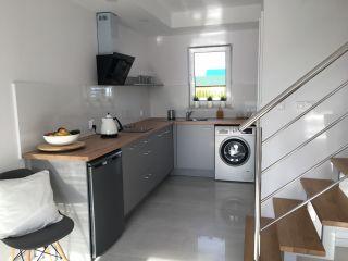 Domki Apartamentowe ITALIA Karwia Kuchnia z lodówką, pralką i zmywarką