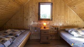 Domki letniskowe NEVADA Darłówko Sypialnia w domku komfort