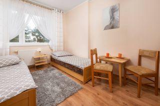 Dom Wypoczynkowy ARKA Jastrzębia Góra Apartament sypialnia