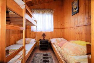 Domki Perłowe Dąbki Domek 4 osobowy -sypialnia
