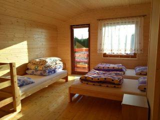 Domki Letniskowe DELFIN Wicie Domki Delfin - Studio LUX z piętrem i balkonem - Pomieszczenie na piętrze