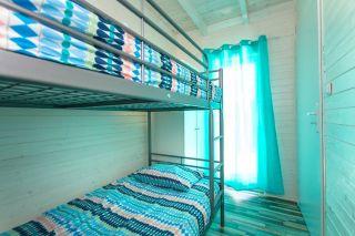 Domki Letniskowe KAPER Karwia Sypialnia dla najmłodszych w domkach parterowych